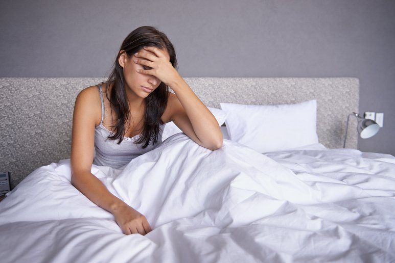 Woman regretting that she bought an innerspring sofa bed mattress