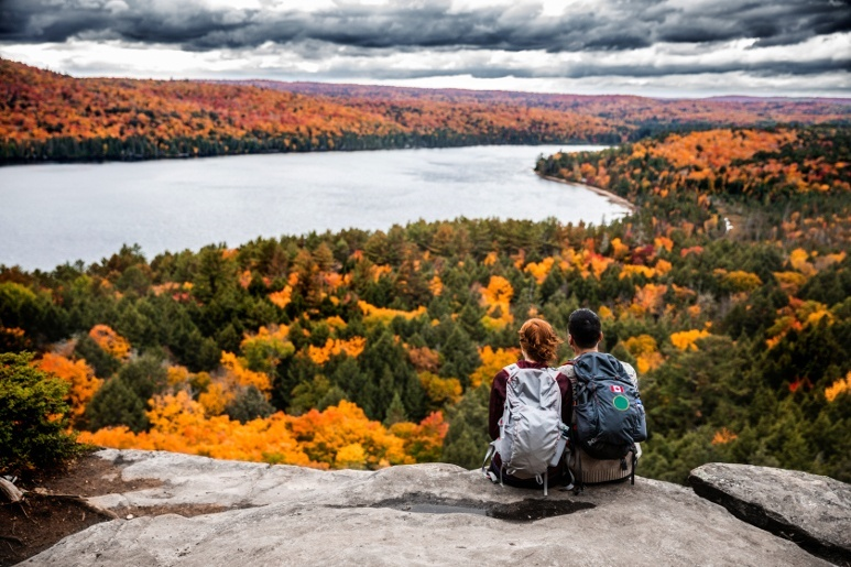 RVing couple hiking and watching autumn landscape