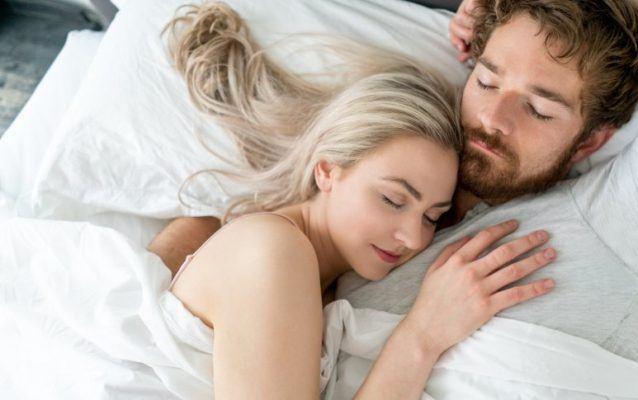 Couple sleeping on memory foam RV mattress