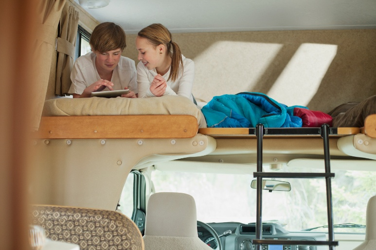 Siblings on RV bunk mattress