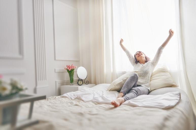 Woman enjoying her new sofa bed mattress