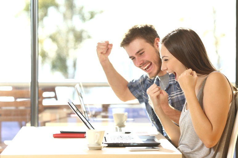 Young couple winning an online RV auction