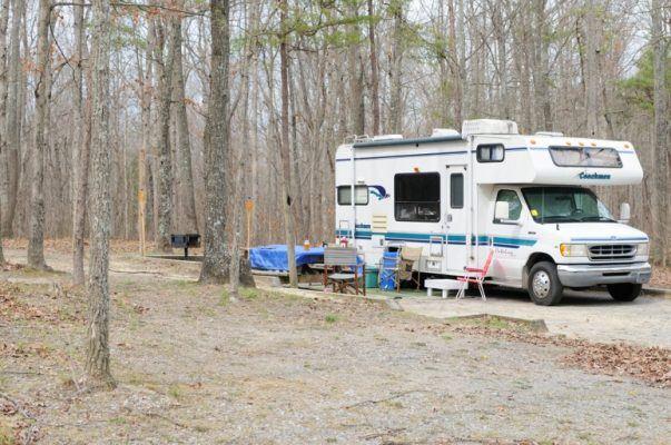 Coachmen RV parked in forest