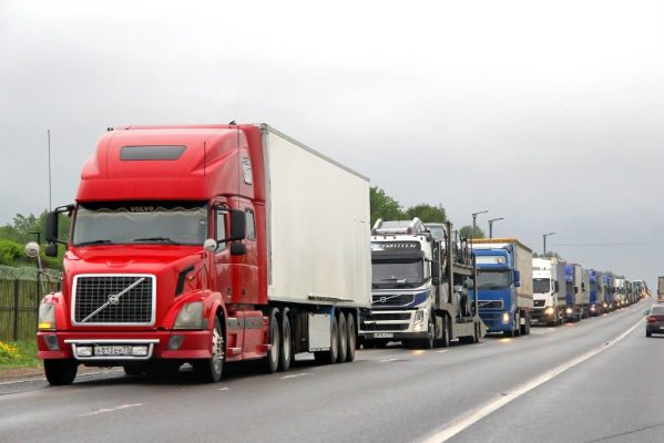 Volvo semi-trucks on the road